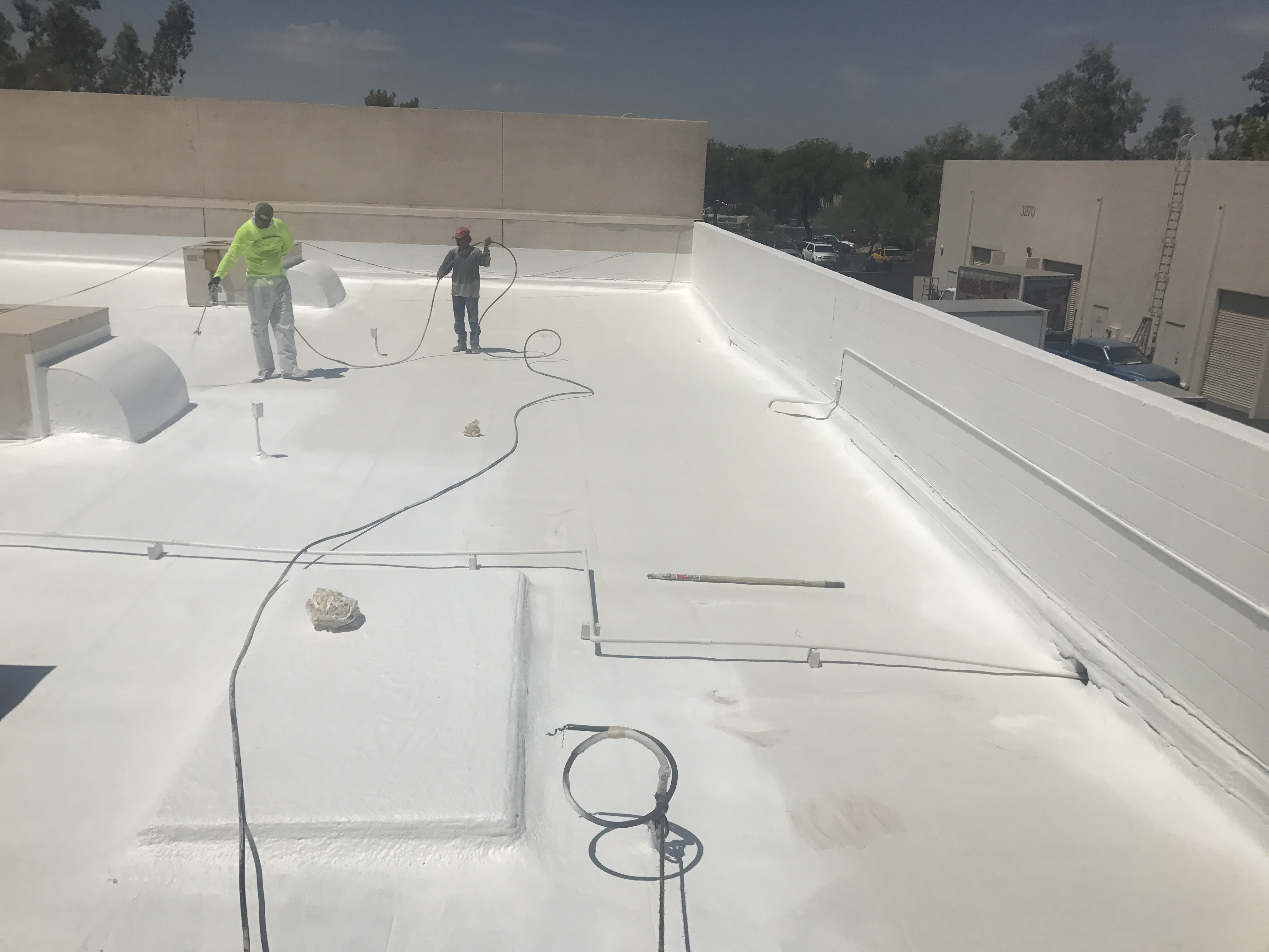 Azul Roofing doing a foam roof in Phoenix, Arizona