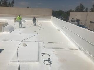 Azul Roofing doing a foam roof in Phoenix, Arizona